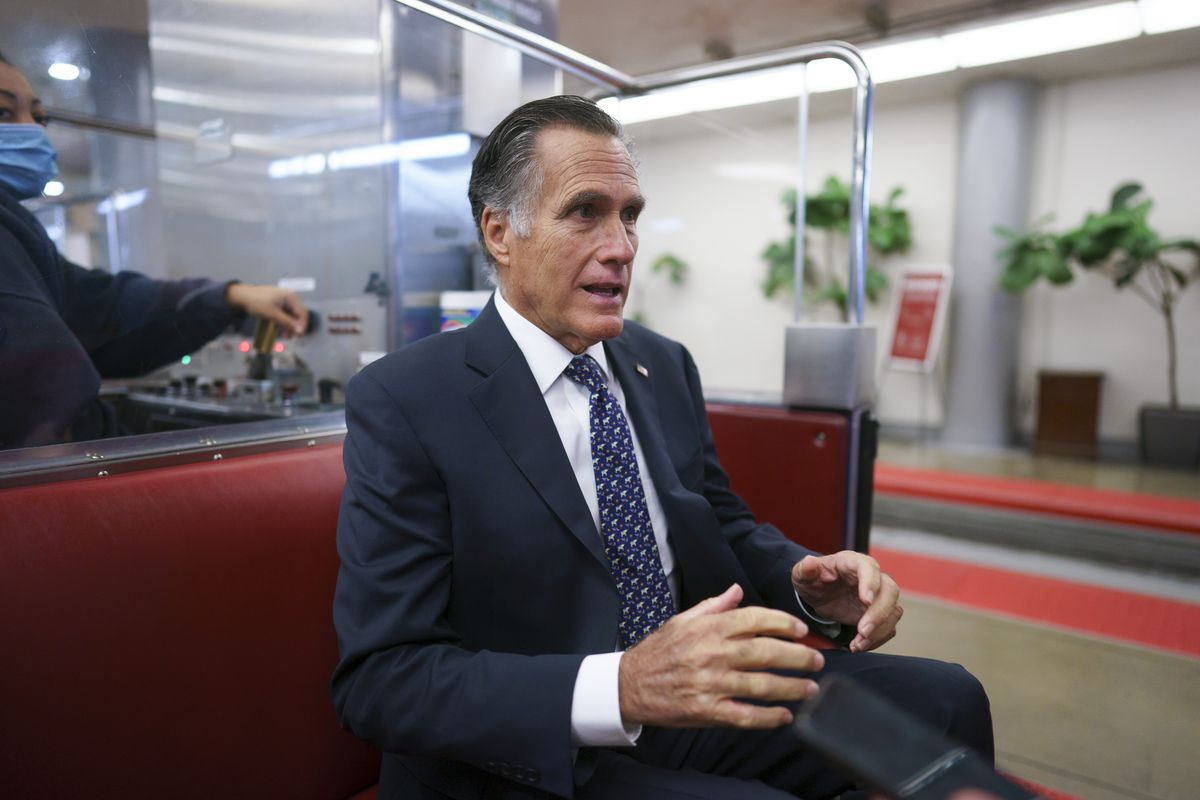 Sen. Mitt Romney, R-Utah, returns to his office after a vote at the Capitol in Washington on Wednesday, Sept. 29, 2021.