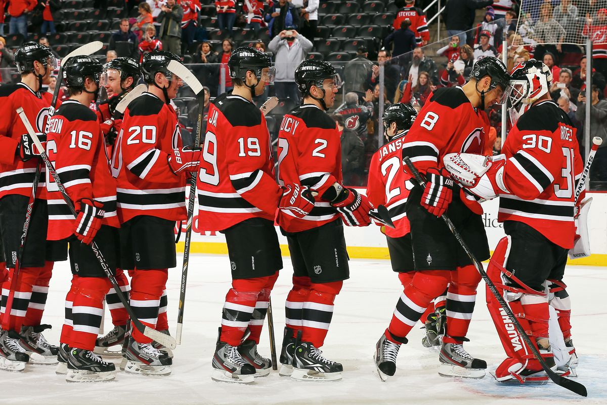 The team lines up to thank the man who made this shutout win possible: Martin Brodeur.