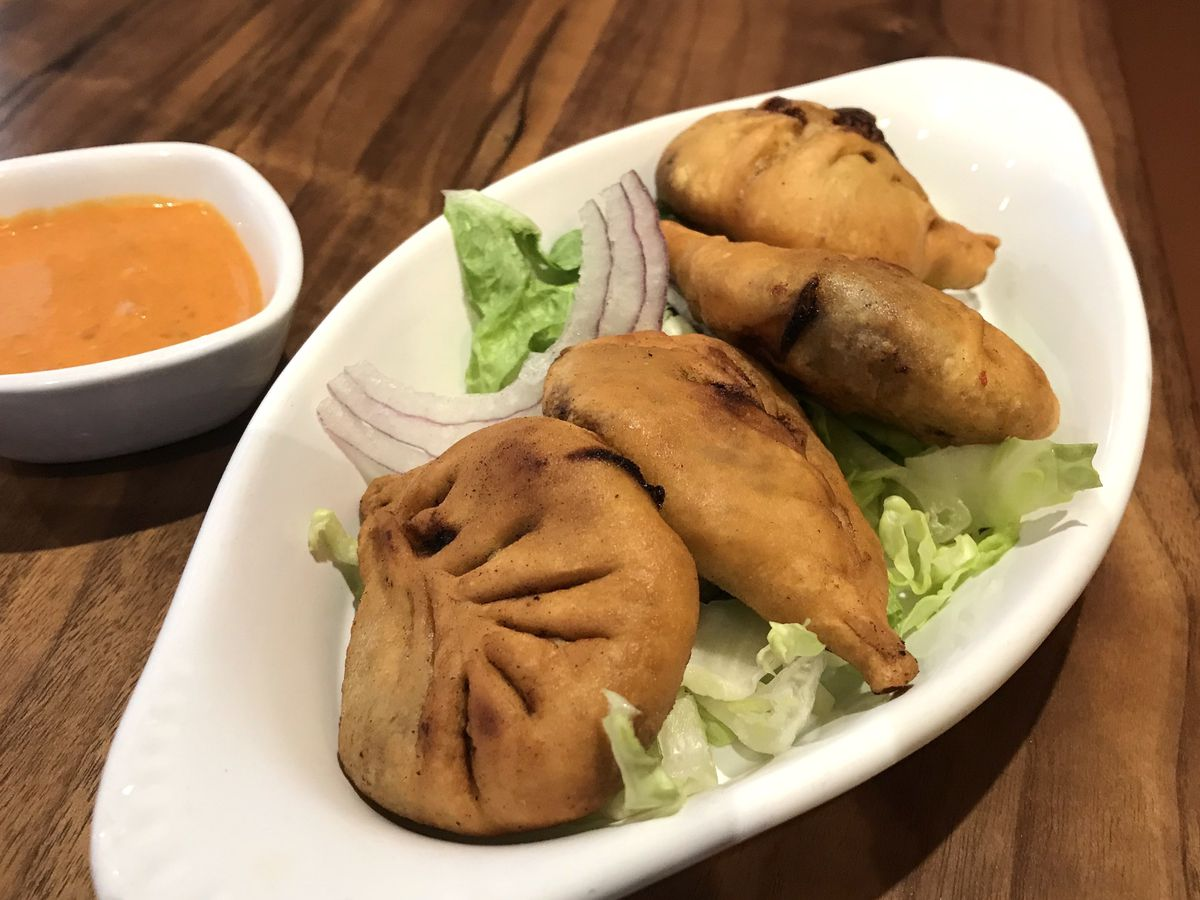 Fried Tibetan beef-onion patties with dipping sauce