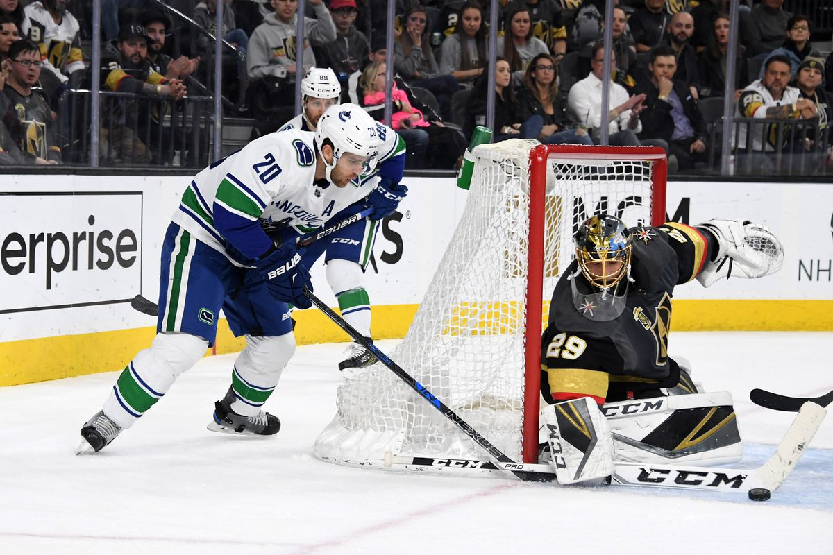 Mar 20, 2018; Las Vegas, NV, USA; Vegas Golden Knights goaltender Marc-Andre Fleury (29) defends the goal against Vancouver Canucks center Brandon Sutter (20) during the first period of an NHL hockey game at T-Mobile Arena.