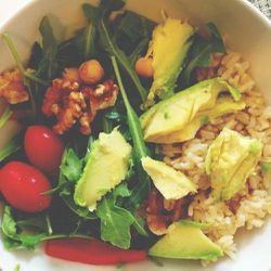 I try to make and bring my lunch when I can. It's usually a bowl of quinoa (this week it was brown rice), whatever veggies I have on hand, greens, and avocado—a serious omega-packed beauty food I can't go a day without.