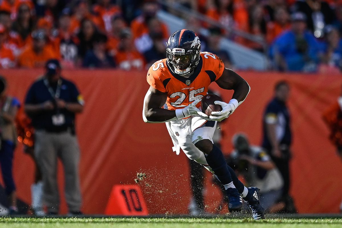 Melvin Gordon #25 of the Denver Broncos runs against the Baltimore Ravens in the third quarter of a game at Empower Field at Mile High on October 3, 2021 in Denver, Colorado.