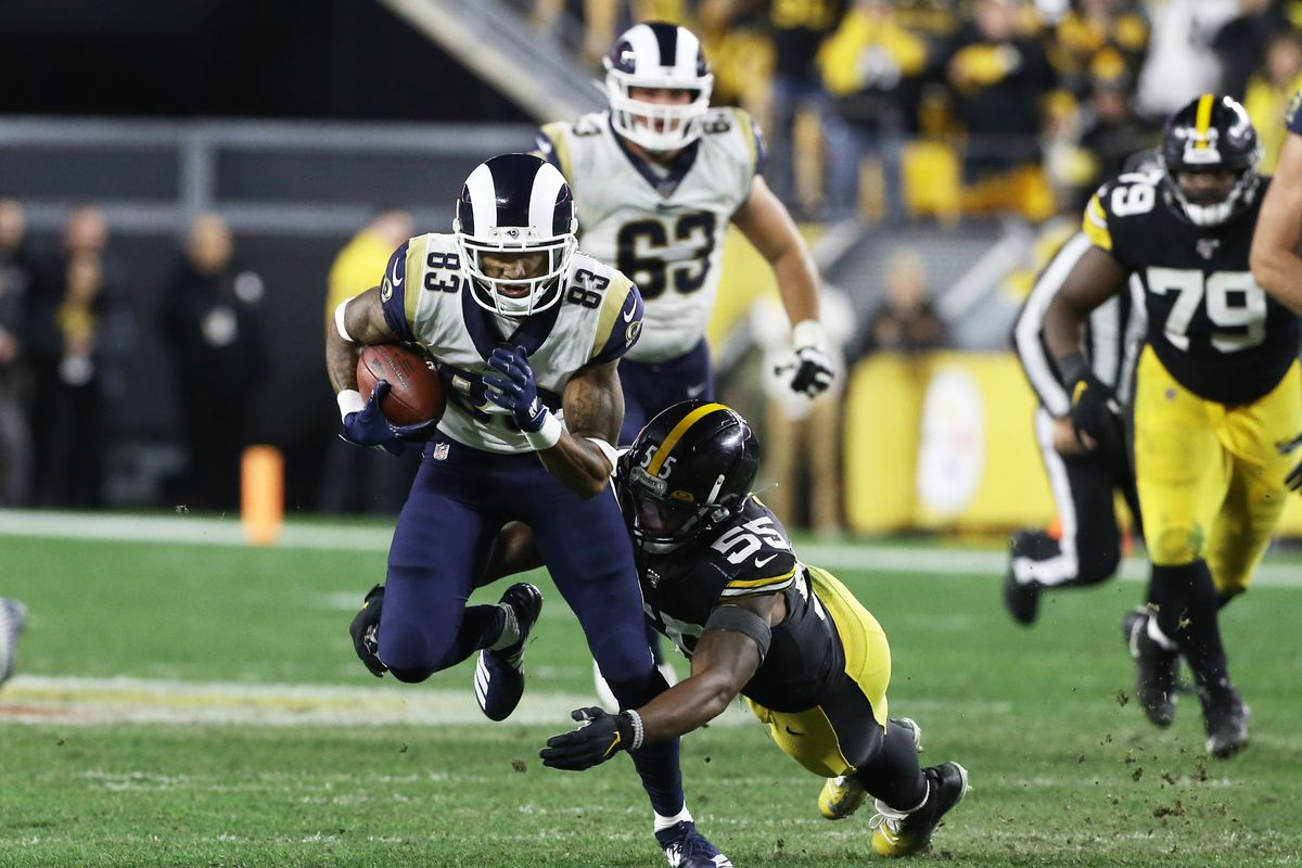 Los Angeles Rams wide receiver Josh Reynolds runs after a catch as Pittsburgh Steelers linebacker Devin Bush tackles during the fourth quarter at Heinz Field.
