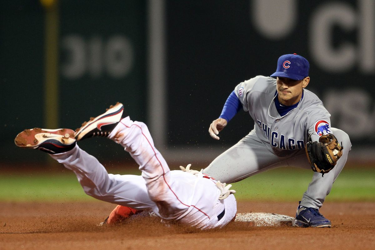 Where's the rest of him? Darwin Barney of the Chicago Cubs catches Jacoby Ellsbury of the Boston Red Sox stealing on May 22, 2011 at Fenway Park in Boston, Massachusetts. (Photo by Elsa/Getty Images)