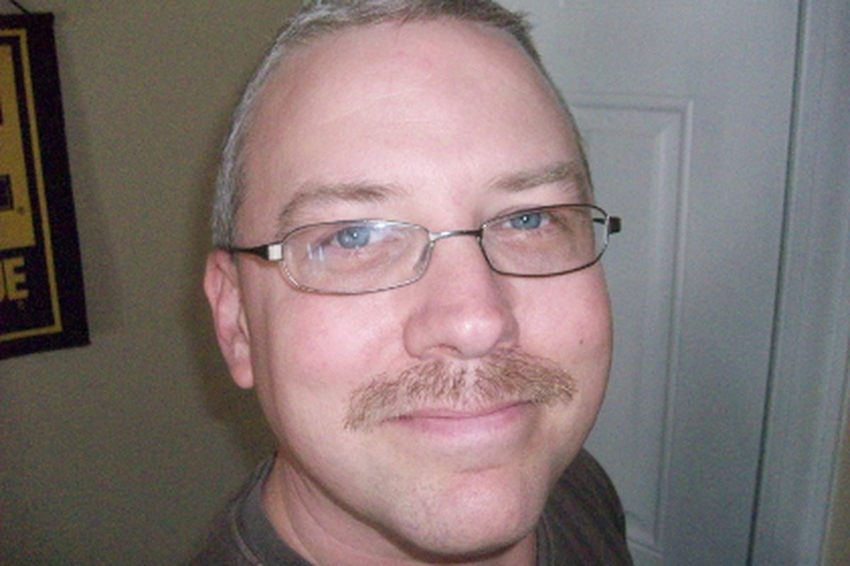 """<em>Feast your eyes on my wondrous mustache, then <a href=""""http://us.movember.com/mospace/882990/"""">head over here</a> and donate some cash!</em>"""