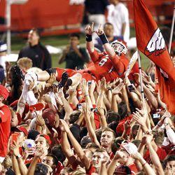 Fans carry Utah Utes quarterback Jon Hays (9) as the University of Utah defeats BYU 24-21 in football Saturday, Sept. 15, 2012, in Salt Lake City, Utah.