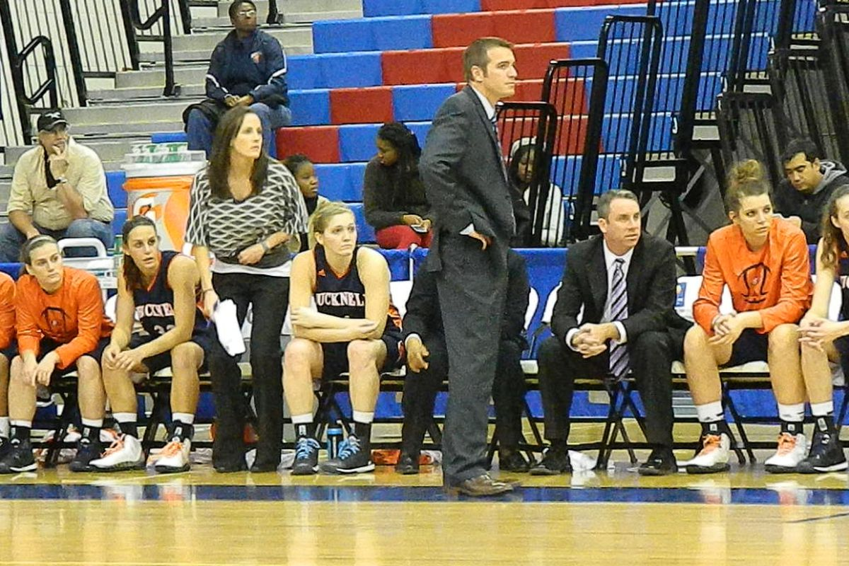 Bucknell head coach Aaron Roussell and Katie standing.