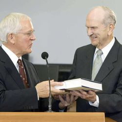 Marlin K. Jensen, church historian for the Church of Jesus Christ of Latter-day Saints (left), presents a copy of the Joseph Smith Papers to Elder Russell M. Nelson of the Quorum of the Twelve Apostles during a press conference introducing the latest volume to be published in the Joseph Smith Papers Project September 22, 2009 in Salt Lake City, Utah.