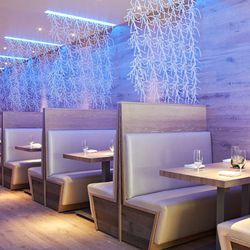 Whitewashed wooden booths with comfortable leather cushions