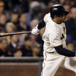 San Francisco Giants' Xavier Nady drives in a run with a single against the Colorado Rockies during the sixth inning of a baseball game on Tuesday, Sept. 18, 2012 in San Francisco.