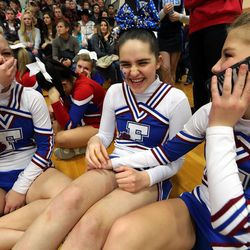 From left, Fremont High School cheerleaders Kennedee Hansen, Kennedy Hansen and Kendee Sanders react as they pretend to have a boy on the phone for Kennedy Hansen at the state championships at Juan Diego Catholic High School in Draper on Saturday, Feb. 15, 2014. Kennedy recently died of juvenile Batten disease.