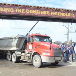 10:32 a.m. Debris hauler backs into the triangle lot -