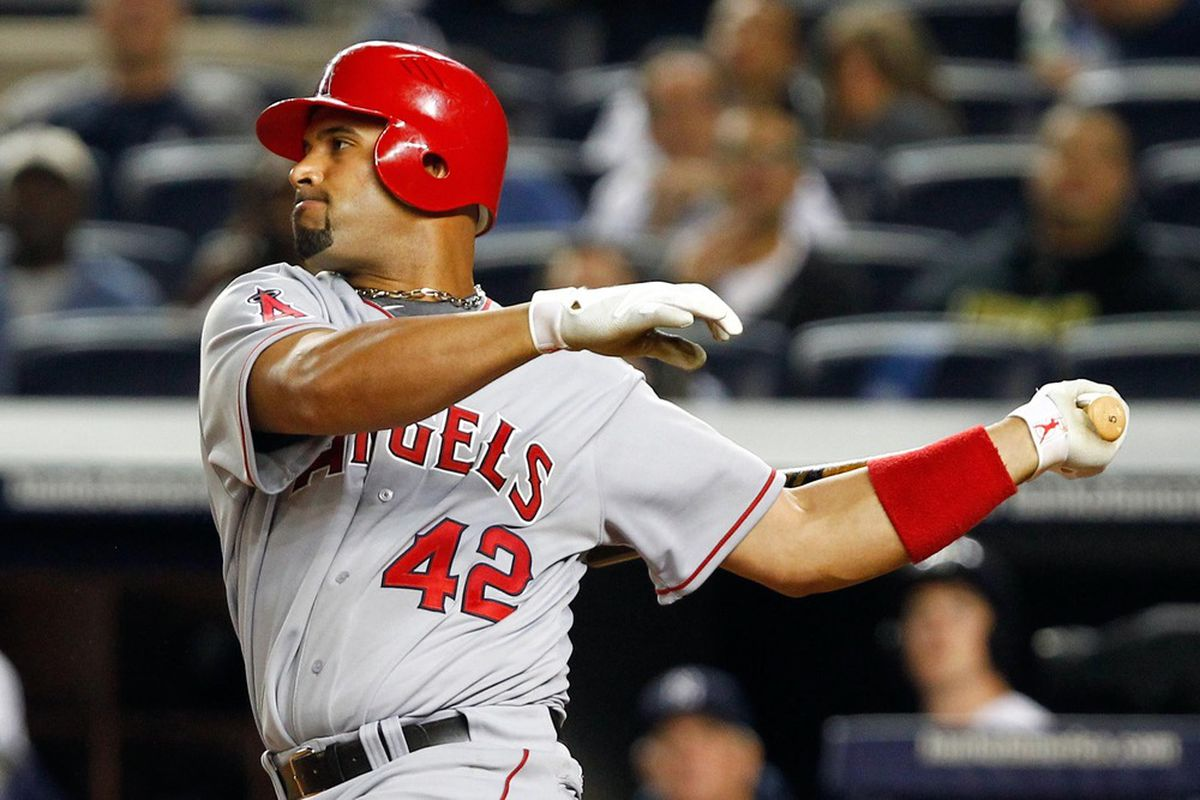 Apr. 15, 2012; Bronx, NY, USA; Los Angeles Angels first baseman Albert Pujols hits an RBI single to left during the seventh inning against the New York Yankees at Yankee Stadium. Yankees won 11-5. Mandatory Credit: Debby Wong-US PRESSWIRE