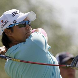 Yani Tseng, of Taiwan, watches her tee shot on the seventh hole during the third round of the LPGA Kraft Nabisco Championship golf tournament in Rancho Mirage, Calif., Saturday, March 31, 2012.