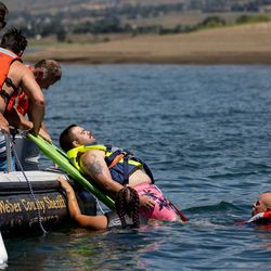 Zane Rich, a Weber Fire District wildland firefighter, is pulled from the water while pretending to be a victim of a boating accident as Weber Fire District and Weber County Sheriff's Office personnel practice water rescue training at Pineview Reservoir near Huntsville, Weber County, on Monday, June 28, 2021.