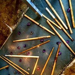 <em>Drumsticks and guitar picks embedded in the floor.</em>