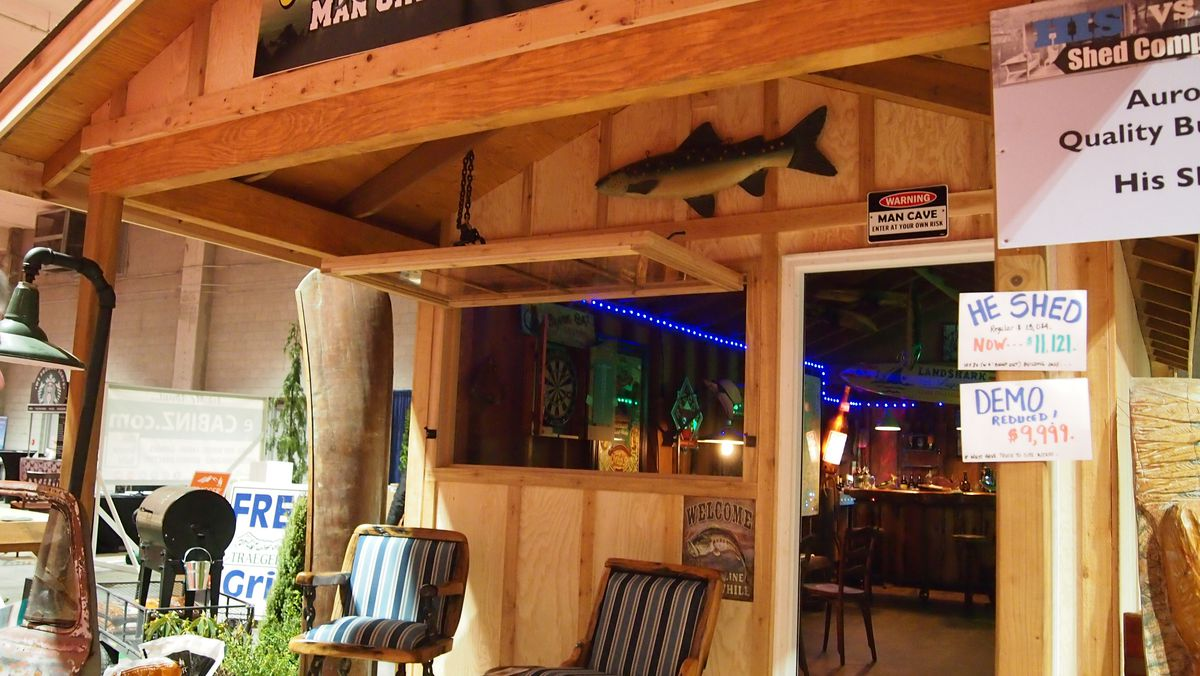 An exposed wood bar with a small porch, made out of a shed