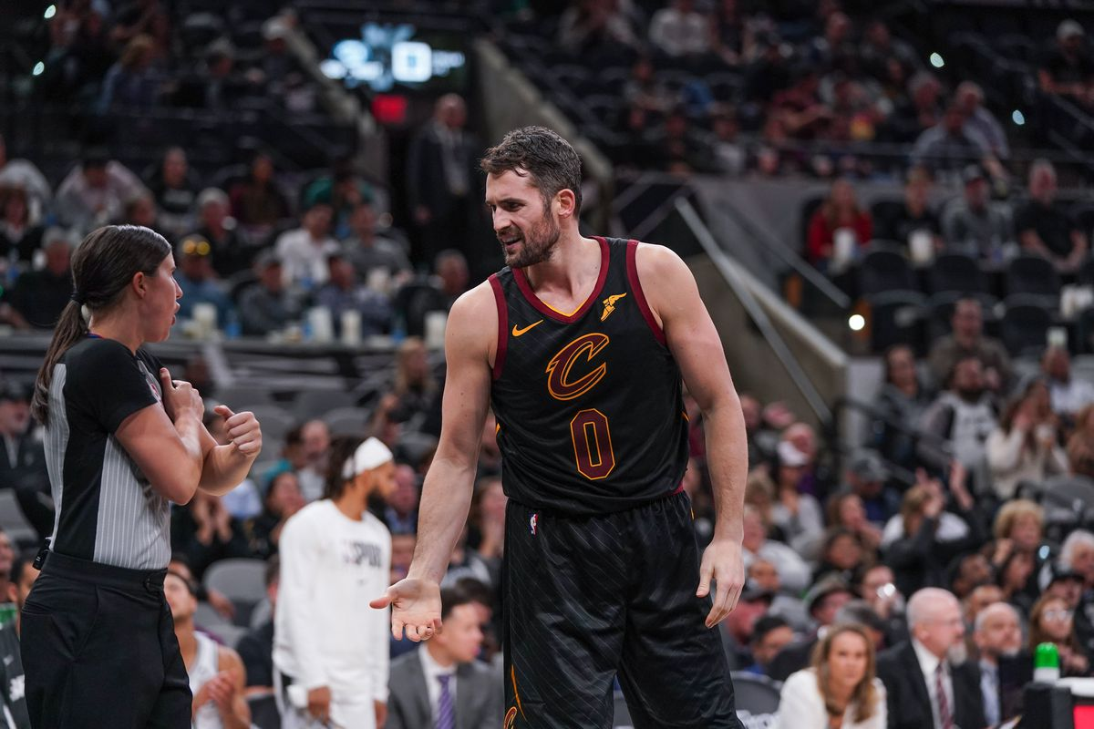 Cleveland Cavaliers forward Kevin Love talks with official Natalie Sago in the second half at the AT&T Center.