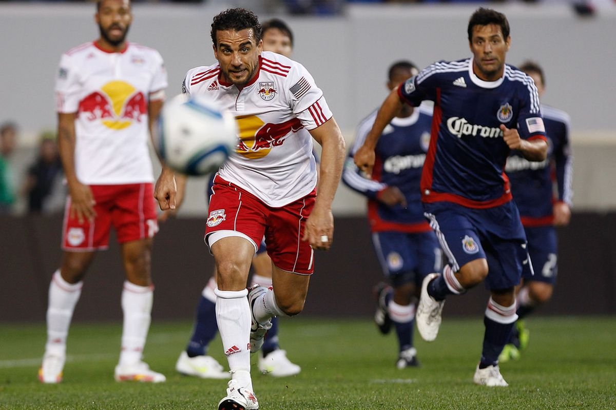 HARRISON, NJ - MAY 15:  Dwayne De Rosario #11 of the New York Red Bulls pursues the ball during thier game against Chivas USA on May 15, 2011 at Red Bull Arena in Harrison, New Jersey.  (Photo by Mike Stobe/Getty Images for New York Red Bulls)