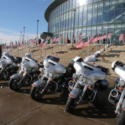 Motorcycles and flags are seen outside the Maverik Center in West Valley City, the site of Unified police officer Doug Barney's funeral on Monday, Jan. 25, 2016. Barney was killed in the line of duty on Jan. 17, 2016.