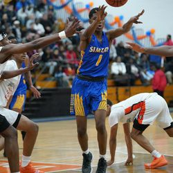 Simeon's Jaylen Drane (1) gets rid of the ball against Young, Wednesday 02-13-19. Worsom Robinson/For the Sun-Times.