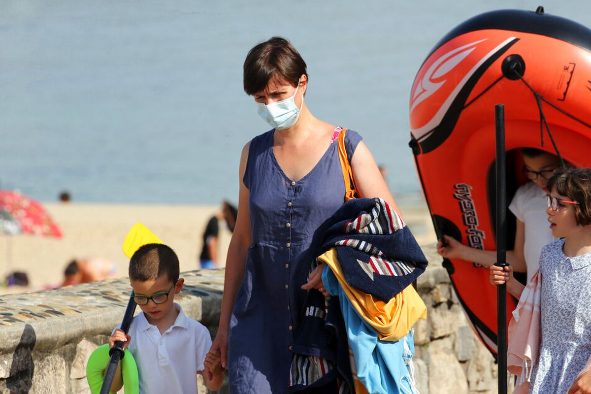 A woman wearing face masks to protect against the delta variant.