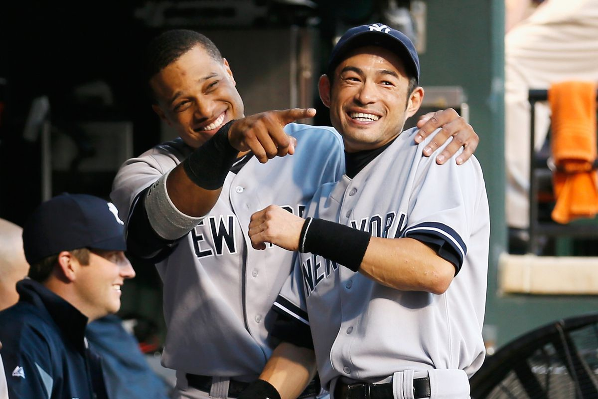 Ichiro and Robinson share a laugh at a Husky joke.