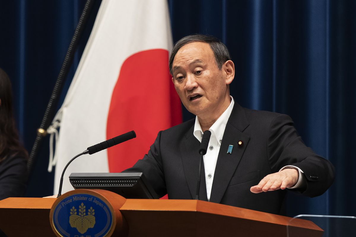Japanese Prime Minister Yoshihide Suga responds to a reporter's question after he spoke at a news conference in Tokyo on Friday, May 7, 2021. Suga announced an extension of a state of emergency in Tokyo and other areas through May 31.