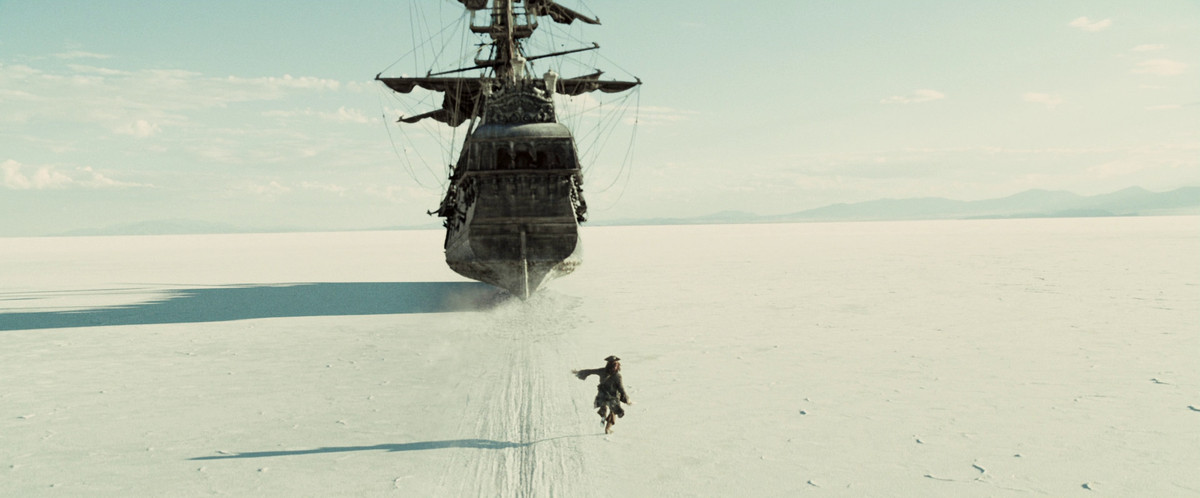a man follows a ship in the middle of an apparent desert in at world's end