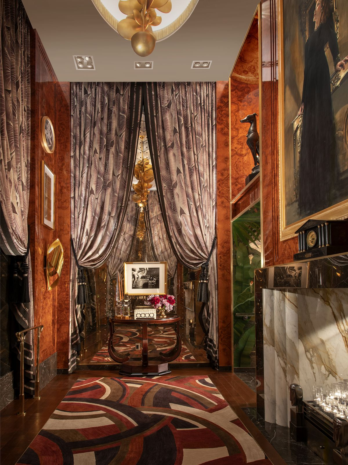 A foyer with opulent curtains