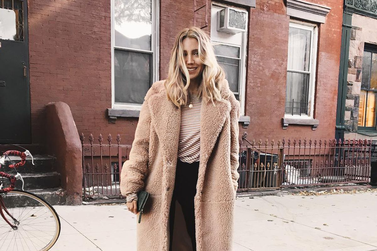 A woman in a brown teddy coat