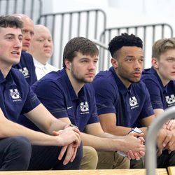 Members of the Utah State men's basketball team listen as new head coach Ryan Odom talks during a press conference Wednesday, April 7, 2021, at the Wayne Estes Center in Logan.