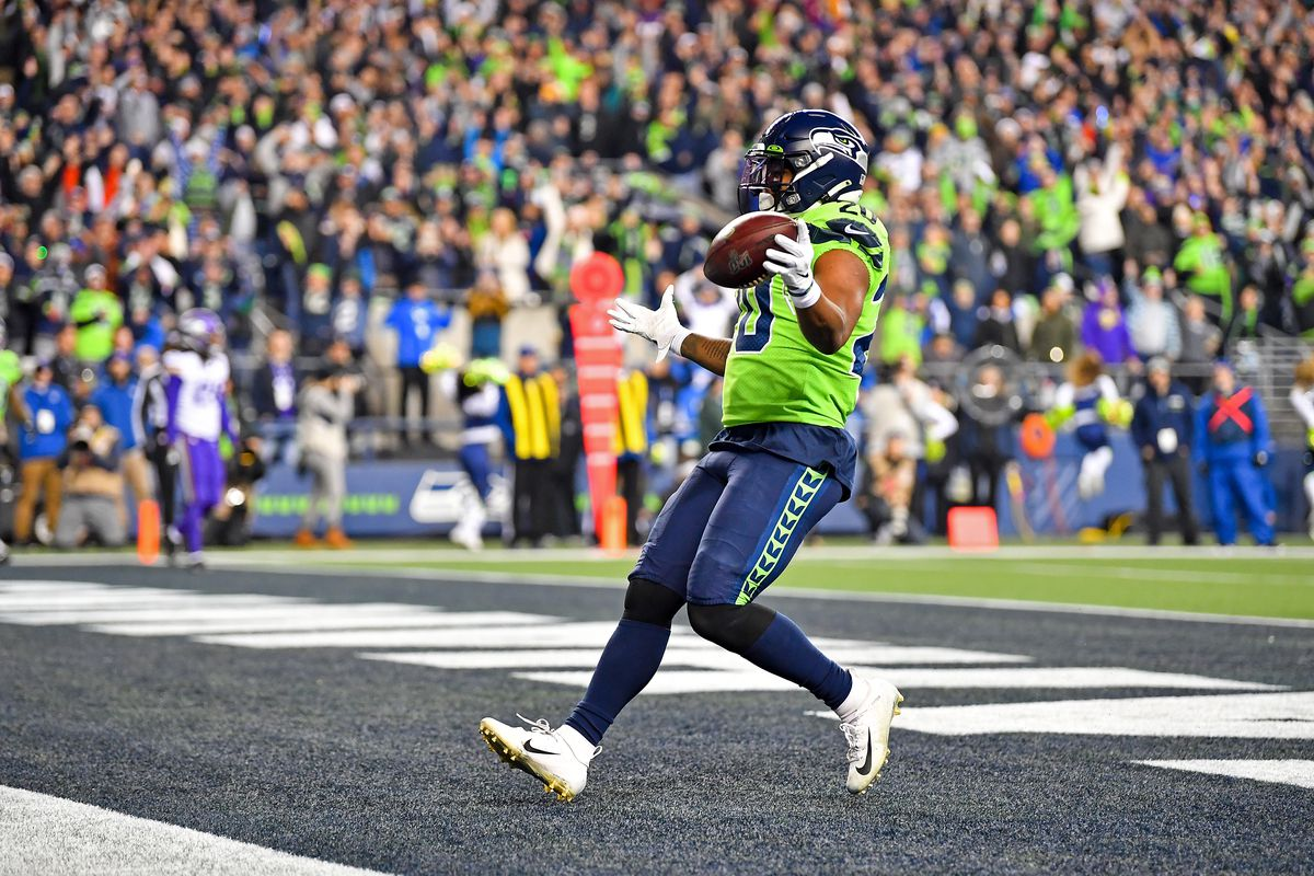 Rashaad Penny of the Seattle Seahawks celebrates after scoring a touchdown during the game against the Minnesota Vikings at CenturyLink Field on December 02, 2019 in Seattle, Washington.