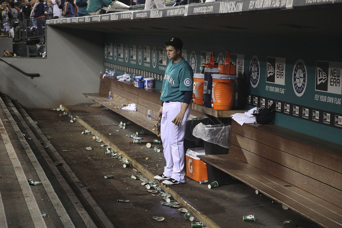 SEATTLE - SEPTEMBER 12:  Justin Smoak #17 of the Seattle Mariners remains in the dugout for a moment after a 9-3 loss to the New York Yankees at Safeco Field on September 12, 2011 in Seattle, Washington. (Photo by Otto Greule Jr/Getty Images)