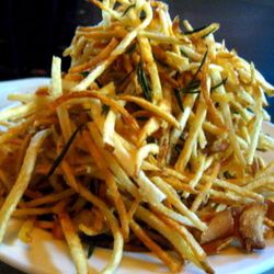 """Shoestring fries: super long and skinny fries, best eaten by the handful. Fun to eat, if you're feeling nutty, with a fork!<br /><br />Found at: The Spotted Pig; PJ Clarke's, Old Town Bar, The Brooklyn Star<br /><br />Photo via <a href=""""http://ddmcfly.wor"""