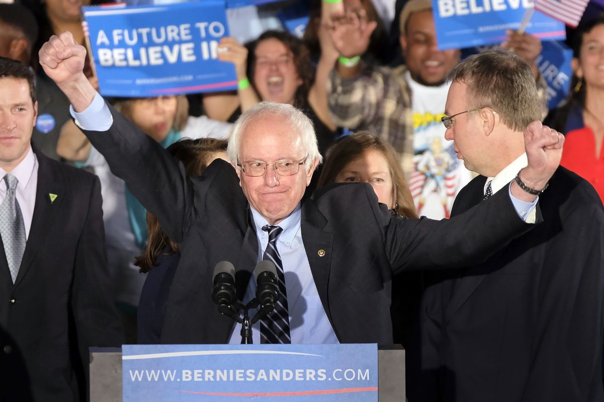 Democratic presidential candidate Sen. Bernie Sanders, I-Vt., reacts to the cheering crowd at his primary night rally on Tuesday. | J. David Ake/AP