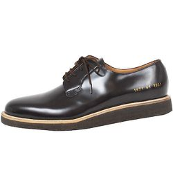 """<strong>Common Projects</strong> Derby Shine 1671 in Brown, <a href=""""http://odinnewyork.com/search.asp?Mode=Product&Type=Shop&TypeID=4&ProductID=3427"""">$495</a> at Odin"""