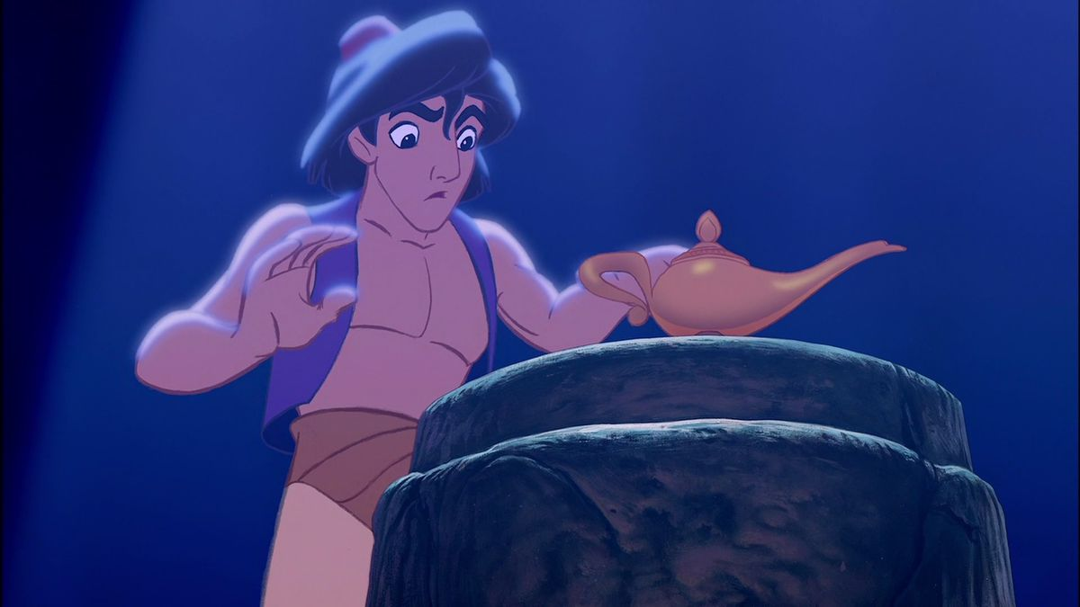 aladdin grabs the lamp in the cave of wonders