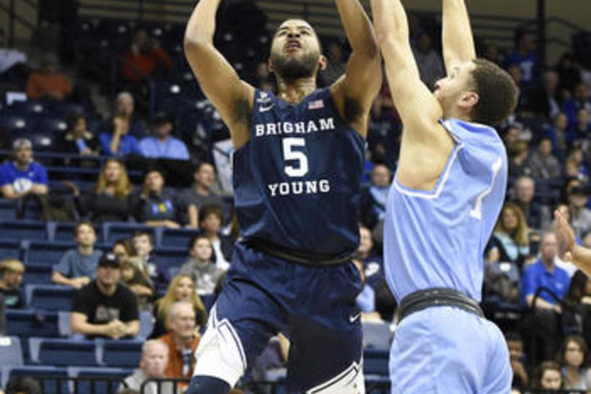 BYU guard L.J. Rose (5) shoots over San Diego guard Tyler Williams (1) during the first half of an NCAA college basketball game Saturday, Jan. 14, 2017, in San Diego.
