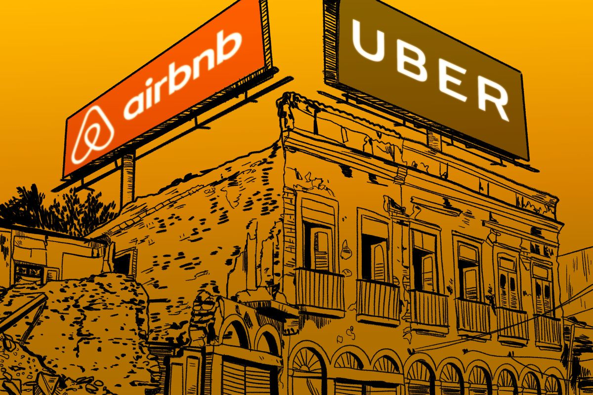 Airbnb and Uber billboards mounted above a town