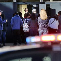 """FILE""""""""Parents enter Mountain View High School in Orem on Tuesday, Nov. 15, 2016, to pick up students after five students were stabbed in an apparent attack by a 16-year-old boy."""