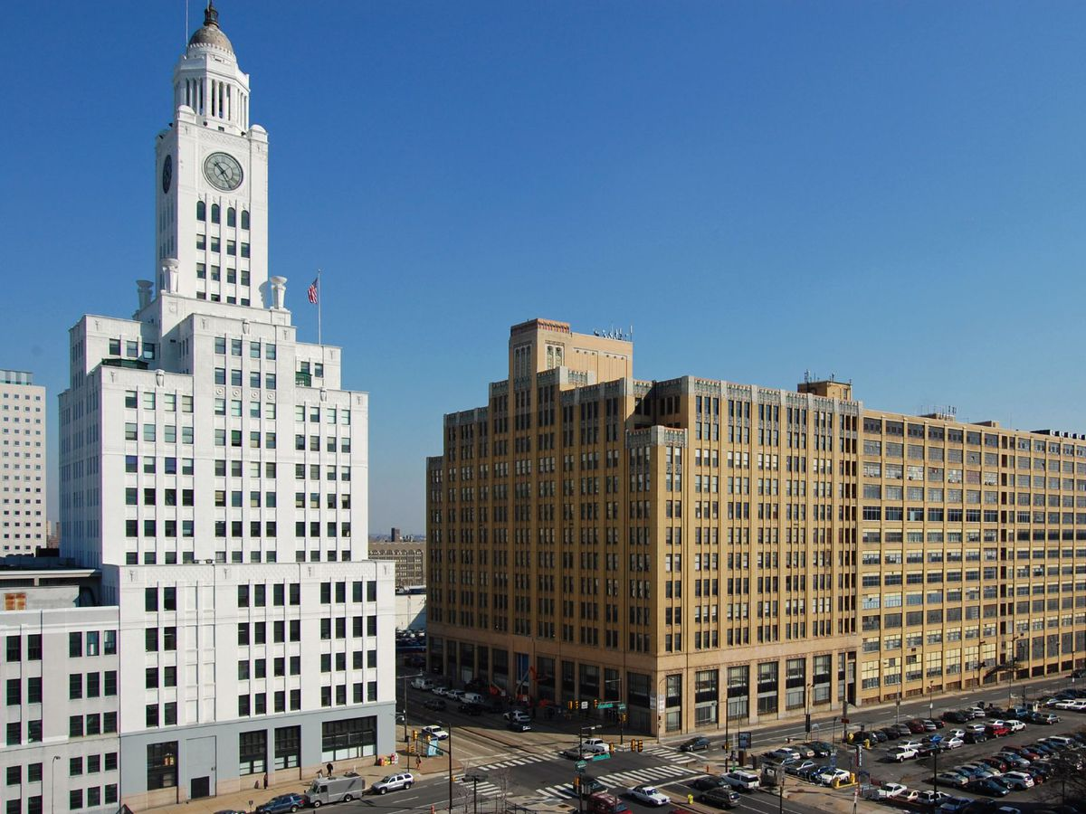 The Old Inquirer building in Philadelphia. The building is tall with a clock at the top of its tower.