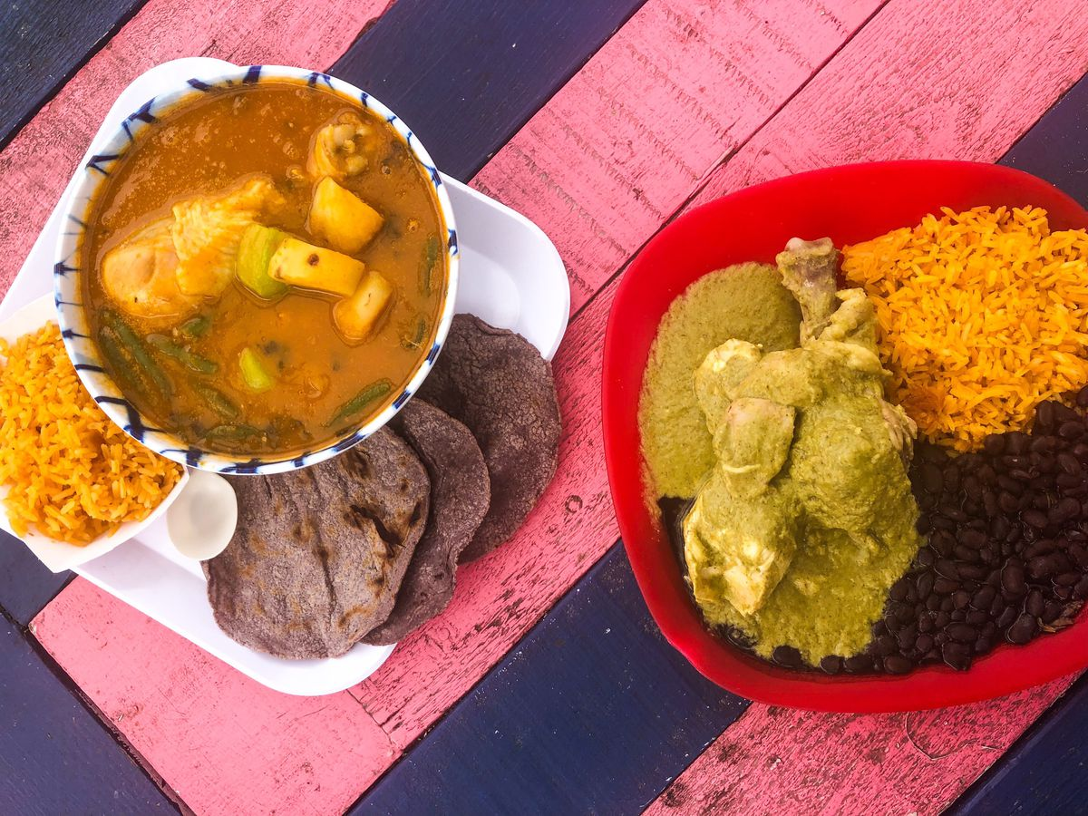 An overhead picture of Tierra del Sol's mole amarillo on the left and mole verde on the right