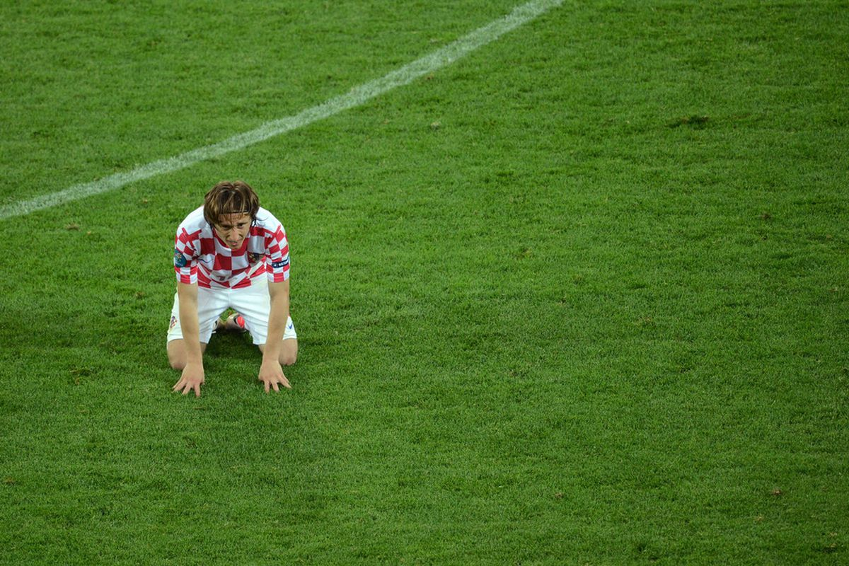 GDANSK, POLAND - JUNE 18:  Luka Modric of Croatia reacts during the UEFA EURO 2012 group C match between Croatia and Spain at The Municipal Stadium on June 18, 2012 in Gdansk, Poland.  (Photo by Jasper Juinen/Getty Images)