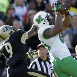 Marshall tight end Gator Hoskins, right, makes a catch for a touchdown in front of Purdue defensive back Anthony Brown during the second half of an NCAA college football game in West Lafayette, Ind., Saturday, Sept. 29, 2012. Purdue defeated Marshall 51-41.