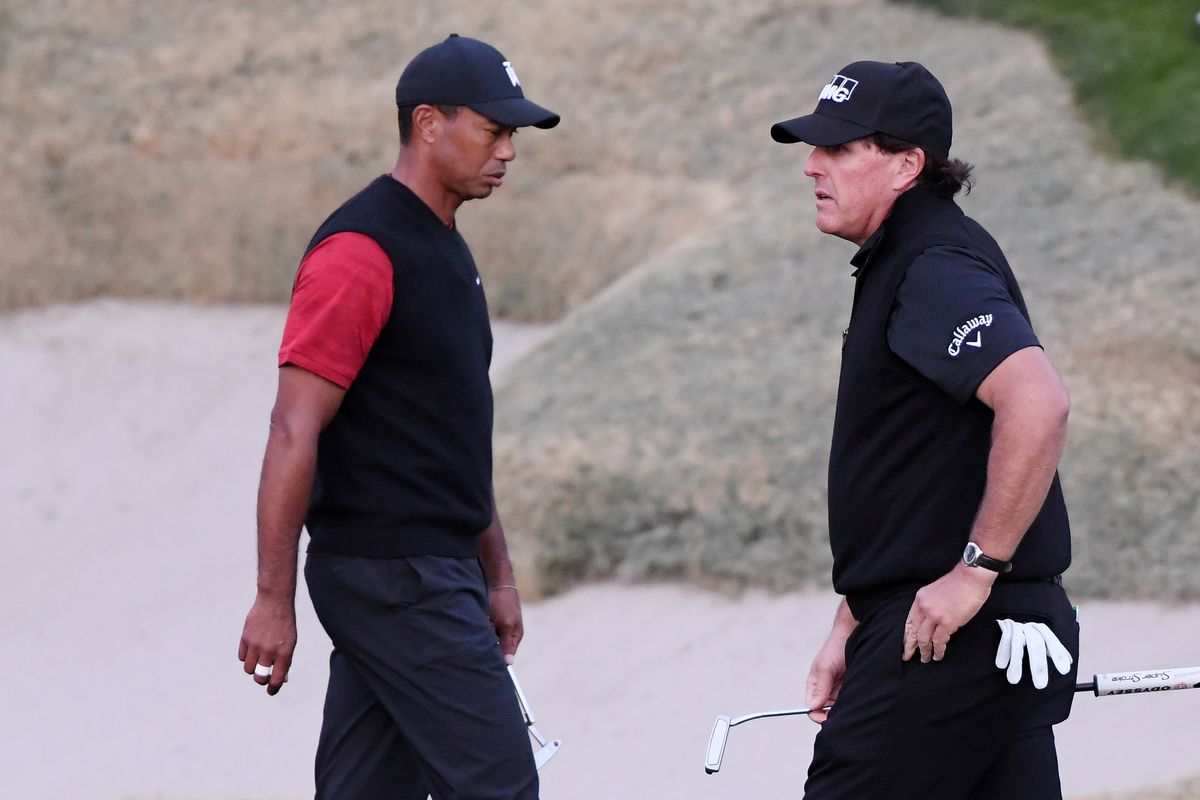 Tiger Woods and Phil Mickelson walk on the 18th hole during The Match: Tiger vs Phil at Shadow Creek Golf Course on November 23, 2018 in Las Vegas, Nevada.