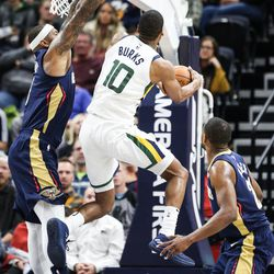 Utah Jazz guard Alec Burks (10) goes up for the shot while New Orleans Pelicans center DeMarcus Cousins (0) applies the defense as Utah hosts New Orleans at Vivint Arena in Salt Lake on Friday, Dec. 1, 2017.