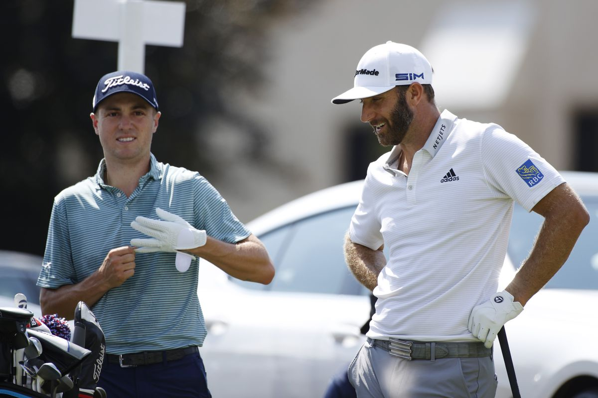 From left to right Justin Thomas talks to Dustin Johnson on the 10th tee during the first round of the BMW Championship golf tournament at Olympia Fields Country Club - North.