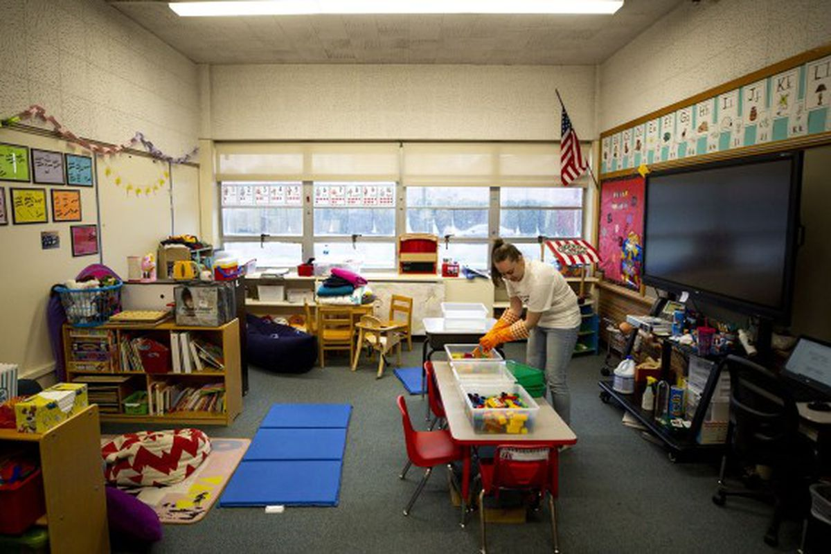 Saralyn Voltz bleaches toys in her preschool classroom at Carson Elementary in Denver on March 13, 2020.