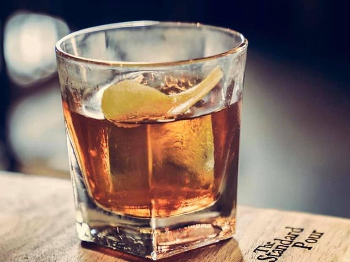 Bourbon cocktail with ice cube